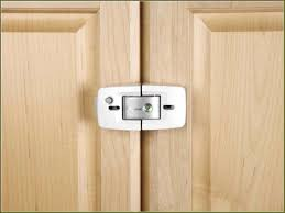 kitchen cabinet door latches lock for cabinet doors with how to install safety 1st spring