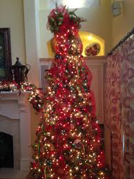 christmas tree using clear and multi colored lights red mesh and