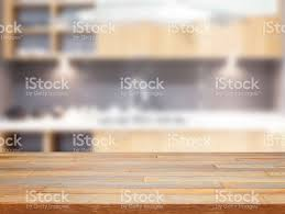 Kitchen Background Empty Wooden Table And Blurred Kitchen Background Stock Photo