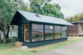 muji unveils trio of tiny prefab homes that can pop up almost