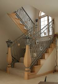 artsy modern stairs ideas with curvy metal banister and black