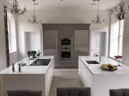 double kitchen island in matt white fitted in aston hertfordshire