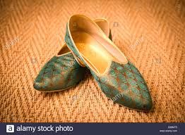 wedding shoes groom asian indian groom wedding shoes placed on a carpet stock photo