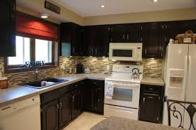 black color staining oak kitchen cabinets with white appliances