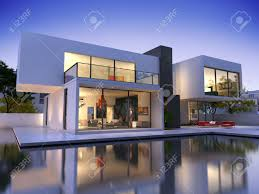 external view of a contemporary house with pool at dusk stock