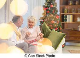 what to get an elderly woman for christmas elderly woman holding christmas present box touching stock