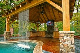 amazing fireplace on deck with beautiful swimming pool and