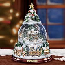 kinkade snowglobe tree lights up and musical