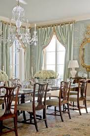 dramatic drapery for an equally dramatic dining room windows