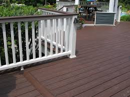 bergendecks project lava rock with white railings outdoors