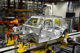 bmw factory assembly line first mini 5 door hatch rolls off the production line