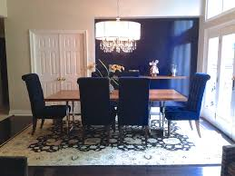 dining room blue fabric cushion with beige lacquered wood dining