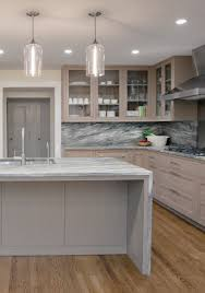 clear glass pendant lights complement cool tones in modern kitchen