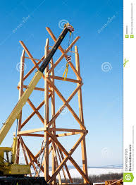 construction of wooden towers using a mobile crane stock photo