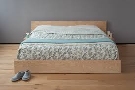 the hand built kulu platform wooden bed is a solid timber modern