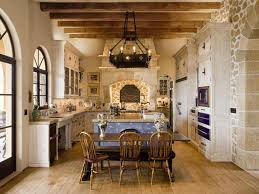 mediterranean kitchen with limestone u0026 wrought iron chandelier in