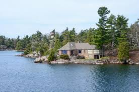 Beach House Usa - one small island and beach house on st lawrence river stock photo
