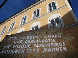 hitler born religion inscribed stone outside house in which adolf hitler was born is