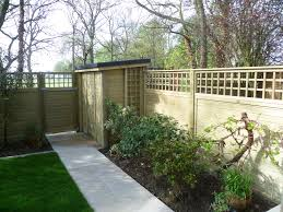 tongue and groove effect fence panels wth a trellis topping