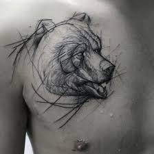 homemade style black and white bear head sketch tattoo on chest