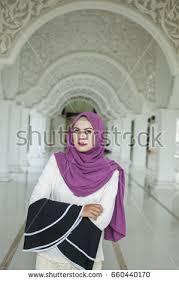 young muslim woman praying mosque stock photo 499035133 shutterstock