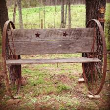 homemade antique bench out of wagon wheels and barn wood pieces