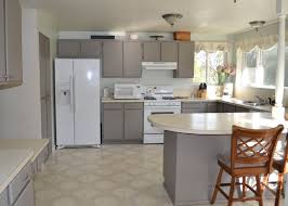 pretty gray oak wood formica kitchen cabinets features white color