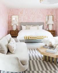 guest bedroom makeover gold glam and millennial pink all over as if the marble walls weren t glam enough samuel brought in chic lavender velvet chairs brass accents and a set of luxe kelly wearstler lamps