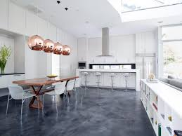 a refinished concrete floor and whitewashed cabinets add to the