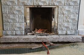 hammer u0026 brush removing a tiled fireplace