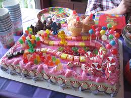 wide pink cake using colorful candy decoration ideas with snake