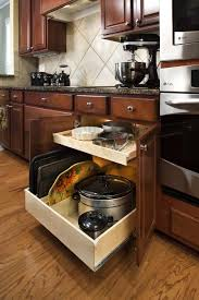 Sliding Kitchen Cabinet Doors Wooden Kitchen Cabinet In Cherry Finished Having Light Brown Trays