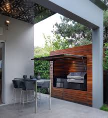 covered outdoor kitchen match with the backyard