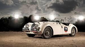 white jaguar car wallpaper hd spot lights upon a white jaguar e type wallpaper car wallpapers