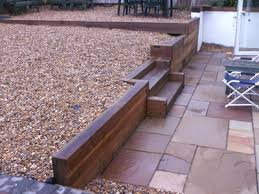 tiered garden granite walls with coping riven slab patio and