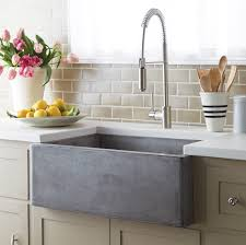 interior stylish single farmhouse sink with white kitchen