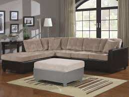 grey bench table with black sofa using light brown cushions white