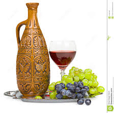 still life clay jug glass of wine and grapes stock photography