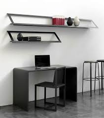 black polished metal wall mounted shelves above gray acrylic study