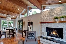 stacked stone fireplace with wood mantle living room transitional