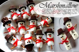 marshmallow snowman winter treats and chocolate dipped pretzel