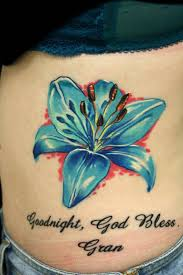 sacred blue pin blue ink flower tattoos on