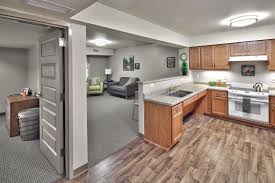 rochester view apartments provide affordable housing designed for photograph of the interior of a residential unit with the kitchen separated from the living room