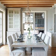 whitewashed dining table with slipcovered chairs cottage in white