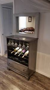 old dresser from the local dumpster upcycled into a wine rack