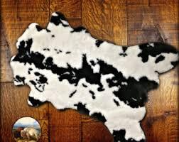 faux cowhide rug etsy