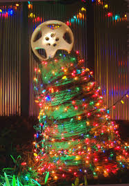 tires made into a outdoor christmas tree site is full of lots of