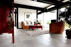 brown living room tiles designs with black sofa set and dining