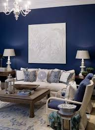 Blue Accent Wall With Cream Fabric And Dark Wood For Living Room - Dark wood furniture living room decorating ideas