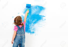 blue paints repair in the apartment happy child paints the wall with